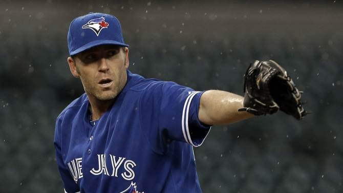 Toronto Blue Jays pitcher Casey Janssen points to first base in the ninth inning of a baseball game against the Detroit Tigers in Detroit, Wednesday April 10, 2013. Toronto won 8-6. (AP Photo/Paul Sancya)