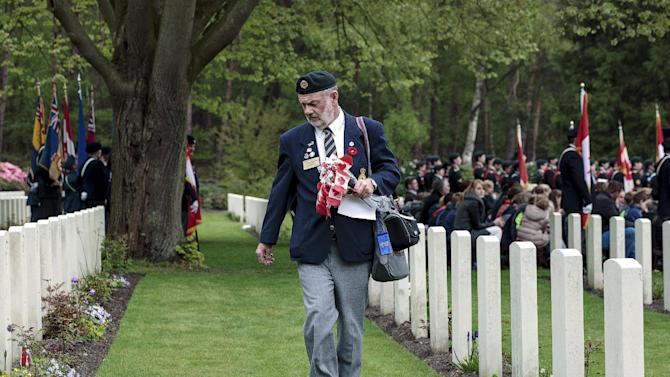 Caregiver Wiseman from Canada looks for graves of veterans from the New Brunswick Regiment during the ceremony of remembrance at the Canadian war cemetery in Holten, the Netherlands