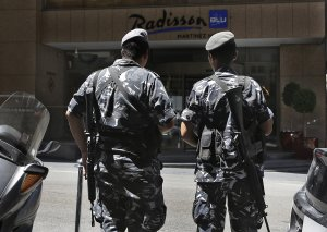 Lebanese policemen stand guard outside a hotel where …