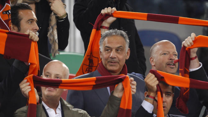 "FILE - In this April 8, 2013 file photo, AS Roma soccer club president James Pallotta, center, follows a Serie A soccer match between AS Roma and Lazio at Rome's Olympic stadium. For Italian football fans, merely mentioning the word ""scudetto"" _ league title _ in association with a favorite club is considered tabu. The theory goes that it's better left unsaid until your squad actually raises the trophy. Yet recently, the word has begun popping up in animated discussions inside Rome's myriad coffee bars and impassioned sports-talk radio stations. The talk, and not only in the capital, is that Roma can put together a serious challenge for the Serie A title this season. Three years after takeover by US owners, Roma is expected to contend for the Serie A title. (AP Photo/Alessandra Tarantino, file)"