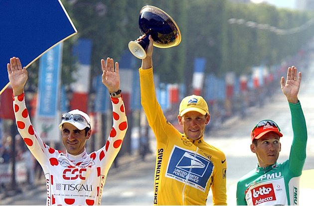 This July 28, 2002 file photo shows Tour de France winner Lance Armstrong, center, flanked by best sprinter Robbie McEwen, of Australia, right, and best climber Laurent Jalabert, of France, after the 