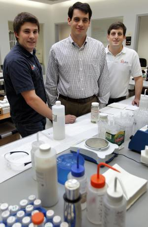 In this Oct. 13, 2011 photo, Brown University graduates, from the left, Michael Woods, Max Winograd, and Ben Lux, stand together in the laboratory of their company NuLabel Technologies, in Providence, R.I.  The three turned from acquaintances into an unlikely business team during their senior year at Brown University during a class on entrepreneurship. (AP Photo/Steven Senne)