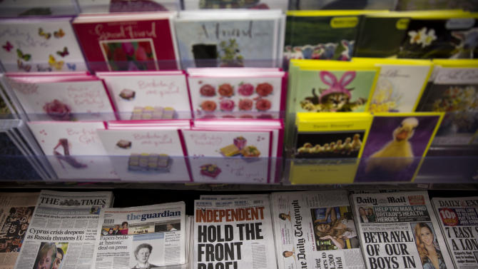 British newspapers are displayed on sale below greeting cards in a newsagents in London, Tuesday, March 19, 2013.  Britain's politicians have finally struck a deal to regulate their country's press. Whether the media will allow itself to be regulated is another question.  Across Britain, newspaper front pages voiced disquiet at the establishment of an independent watchdog which would have the power to order prominent apologies and take complaints into arbitration.  (AP Photo/Matt Dunham)
