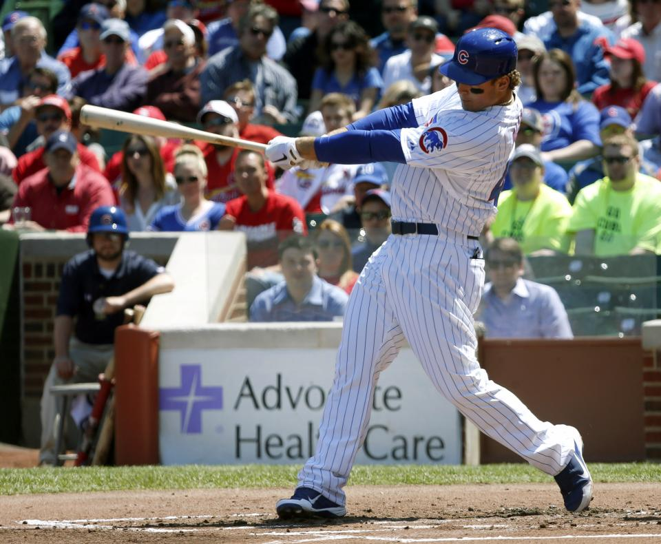 Chicago Cubs' Anthony Rizzo hits an RBI double off St. Louis Cardinals starting pitcher Jake Westbrook, scoring Luis Valbuena, during the first inning of a baseball game, Wednesday, May 8, 2013, in Chicago. (AP Photo/Charles Rex Arbogast)
