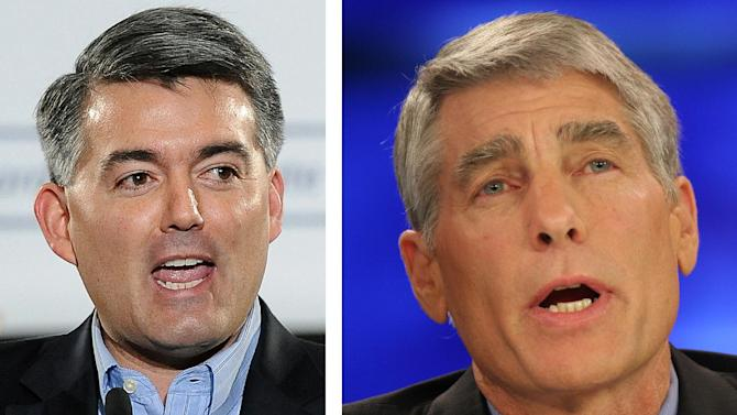 This combo of file photos shows Rep. Cory Gardner, R-Colo., speaks during an event in Denver in a March 1, 2014 file photo, left, and then Colorado Democratic Senatorial candidate Mark Udall in a Oct. 16, 2008 file photo. Facing off in one of the most contested Senate races in the nation, Udall and Gardner, found something to agree on this week _ giving President Barack Obama the authority he's asked for to train and arm Syrian rebels taking on brutal Islamic State militants.  (AP Photo/Files)