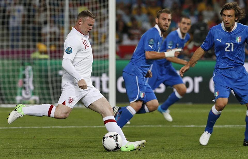 Italy's Andrea Pirlo, right, looks on as England's Wayne Rooney controls the ball during the Euro 2012 soccer championship quarterfinal match between England and Italy in Kiev, Ukraine, Sunday, June 24, 2012. (AP Photo/Michael Sohn)