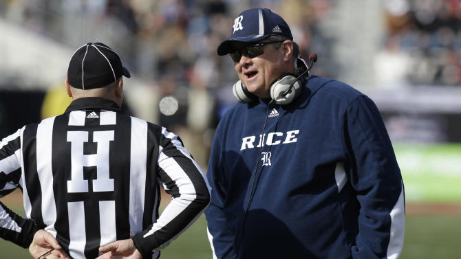 Rice head coach Troy Calhoun talks with head linesman Chad Green during the first half of the Armed Forces Bowl NCAA college football game against the Air Force, Saturday, Dec. 29, 2012, in Fort Worth, Texas. (AP Photo/LM Otero)