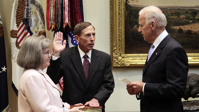 FILE - This Sept. 6, 2011 file photo shows Holly Knowlton Petraeus holding the family bible as her husband David Petraeus is sworn in by Vice President Joe Biden as CIA Director, in the Roosevelt Room of the White House in Washington. Petraeus has resigned as director of the CIA after admitting he had an extramarital affair. (AP Photo/Pablo Martinez Monsivais, File)