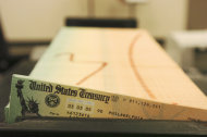 FILE - In this Feb. 11, 2005 file photo, trays of printed social security checks wait to be mailed from the U.S. Treasury's Financial Management services facility in Philadelphia. Social Security recipients will get a raise in January _ their first increase in benefits since 2009. Experts expect the increase will be about 3.5 percent. Some 55 million beneficiaries find out for sure Wednesday when an inflation measure that determines the annual cost-of-living adjustment is released. (AP Photo/Bradley C. Bower, File)