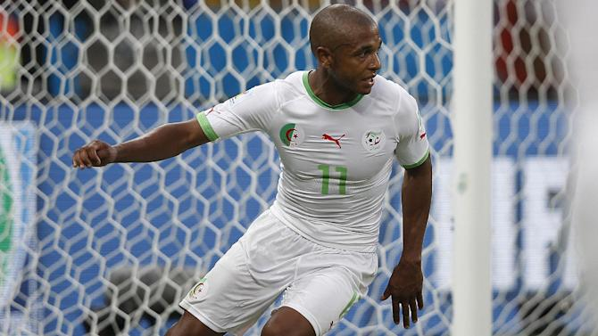 Algeria's midfielder Yacine Brahimi celebrates scoring during a Group H football match between South Korea and Algeria at the Beira-Rio Stadium in Porto Alegre during the 2014 FIFA World Cup on June 22, 2014