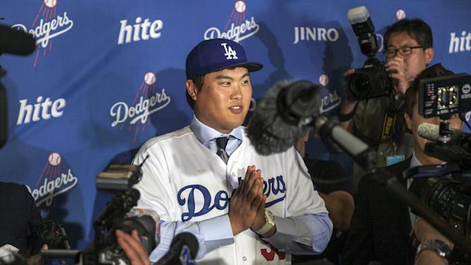 New Los Angeles Dodgers pitcher Ryu Hyun-jin, of South Korea, takes questions from reporters following a baseball news conference announcing his $36 million, six-year contract, Monday, Dec. 10, 2012, in Los Angeles. Ryu becomes the first player to go directly from the Korea Baseball Organization to the United States big leagues. (AP Photo/Damian Dovarganes)