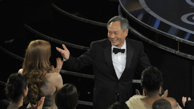 "Ang Lee walks on stage to accept the award for best directing for ""Life of Pi"" during the Oscars at the Dolby Theatre on Sunday Feb. 24, 2013, in Los Angeles.  (Photo by Chris Pizzello/Invision/AP)"