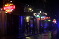 A deserted Bourbon Street in the French Quarter is shown as Hurricane Isaac makes landfall Tuesday, Aug. 28, 2012, in New Orleans. Hurricane Isaac made landfall south of New Orleans Tuesday night. (AP Photo/David J. Phillip)