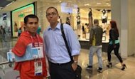 Paralympian Isidro Vildosola with the writer in Westfield Mall, Stratford City in London.  Photo by RYAN ESTEVES.