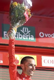 Katusha Team's Rodriguez celebrates after taking the overall lead after the eighth stage of the Tour of Spain