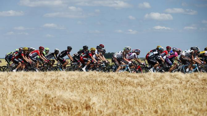 The pack of riders cycles during the third stage of the 102nd Tour de France cycling race from Anvers to Huy