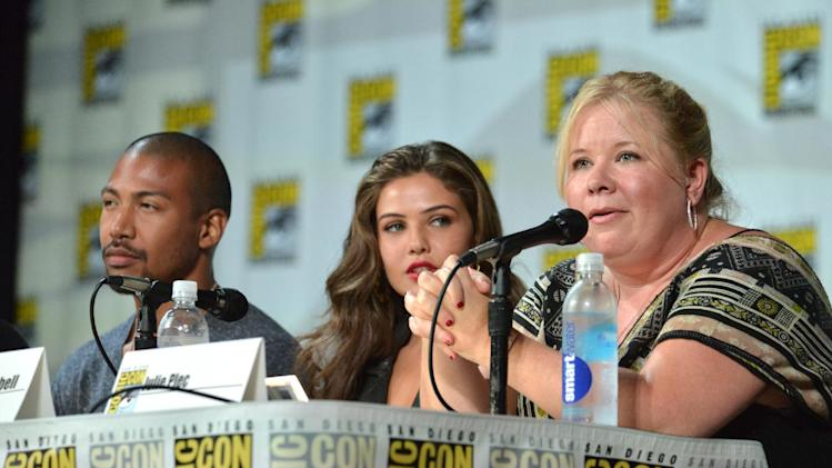 "Charles Michael Davis and from left, Danielle Campbell and producer Julie Plec attend ""The Originals"" panel on Day 2 of Comic-Con International on Friday, July 25, 2014, in San Diego. (Photo by Richard Shotwell/Invision/AP)"