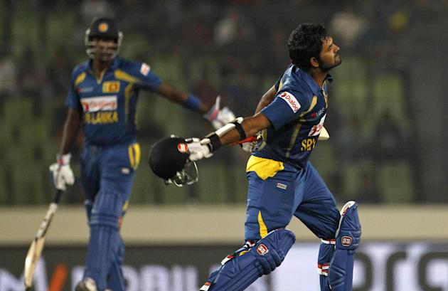 Sri Lanka's Lahiru Thirimanne, right, celebrates after scoring a century during the Asia Cup final cricket match between Sri Lanka and Pakistan in Dhaka, Bangladesh, Saturday, March 8, 2014. (AP Photo