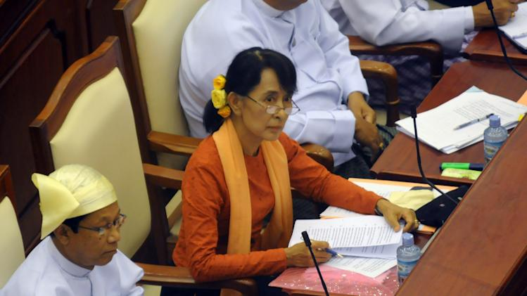 Myanmar Opposition leader Aung San Suu Kyi, center, attends a regular session of the parliament at Myanmar's Lower House in Naypyitaw Wednesday, July 11, 2012, in Naypyitaw, Myanmar.  (AP Photo)