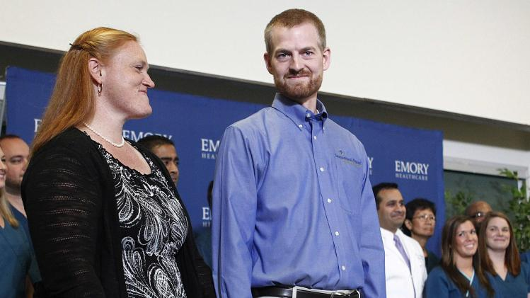 Brantly who contracted the deadly virus Ebola, and wife Amber during a press conference at Emory University Hospital in Atlanta