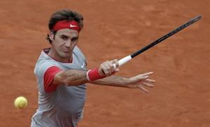 Roger Federer of Switzerland prepares to return the ball to Ernests Gulbis of Latvia during their men's singles match at the French Open tennis tournament at the Roland Garros stadium in Paris