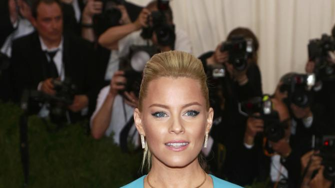 """U.S. actress Elizabeth Banks arrives for the Metropolitan Museum of Art Costume Institute Gala 2015 celebrating the opening of """"China: Through the Looking Glass,"""" in Manhattan"""