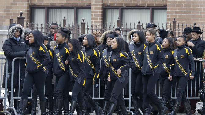 Members of the Crystal Elegance Majorettes arrive at the Greater Harvest Missionary Baptist Church for the funeral service of Hadiya Pendleton, also a member of the majorette team, Saturday, Feb. 9, 2013, in Chicago. The shooting death of the 15-year-old honor student has drawn attention to the staggering gun violence in the nation's third-largest city. (AP Photo/Nam Y. Huh)