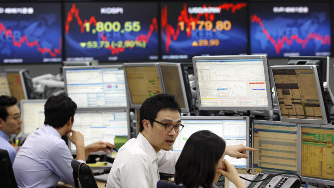 Currency traders work in front of the screen showing the Korea Composite Stock Price Index and the exchange rate between the U.S. dollar and the South Korean won at the foreign exchange dealing room of the Korea Exchange Bank headquarters in Seoul, South Korea, Thursday, Sept. 22, 2011. The Korea Composite Stock Price Index fell 2.90 percent, or 53.73, to close at 1,800.55. (AP Photo/Lee Jin-man)
