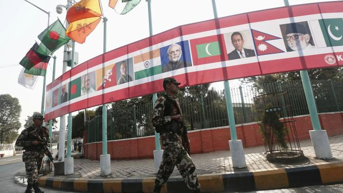 Soldiers patrol outside the venue hosting the opening session of 18th SAARC summit in Kathmandu