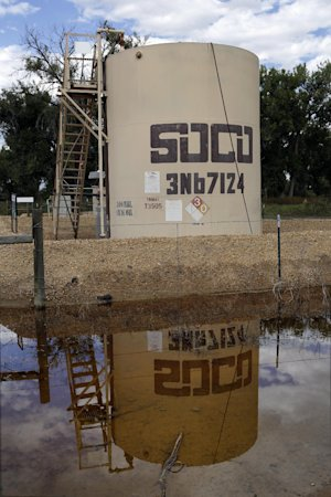 In this Wednesday, Sept. 18, 2013 photo, an oil well…