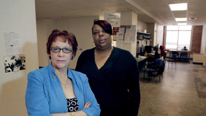 In this March 19, 2013 photo, Evelyn Craig, left, executive director of reStart Inc., and LaTonya Jenkins, a reStart client who lives at the facility, pose at the homeless shelter in Kansas City, Mo. The women are concerned that Missouri's refusal to expand Medicaid under the Affordable Care Act will harm residents of the shelter like Jenkins. (AP Photo/Charlie Riedel)