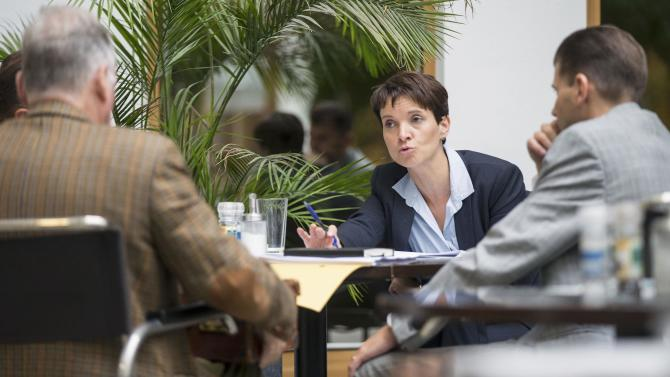 Petry party leader of Alternative fuer Deutschland talks to party members before a news conference in Berlin
