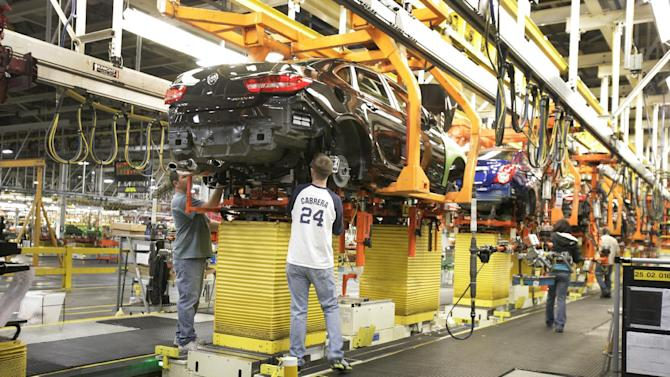 In this  April 25, 2012 photo, a drive train assembly is mated to a Buick Verano at the Orion Assembly plant in Orion Township, Mich. Nearly four years after GM filed for bankruptcy protection, the automaker is building the Verano and the Sonic, the best-selling subcompact car in the nation. (AP Photo/Duane Burleson)