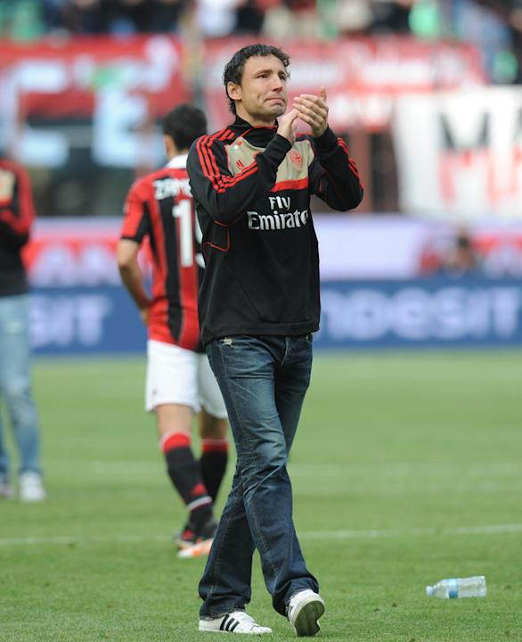 AC Milan's Midfielder Mark Van Bommel Applauds AFP/Getty Images