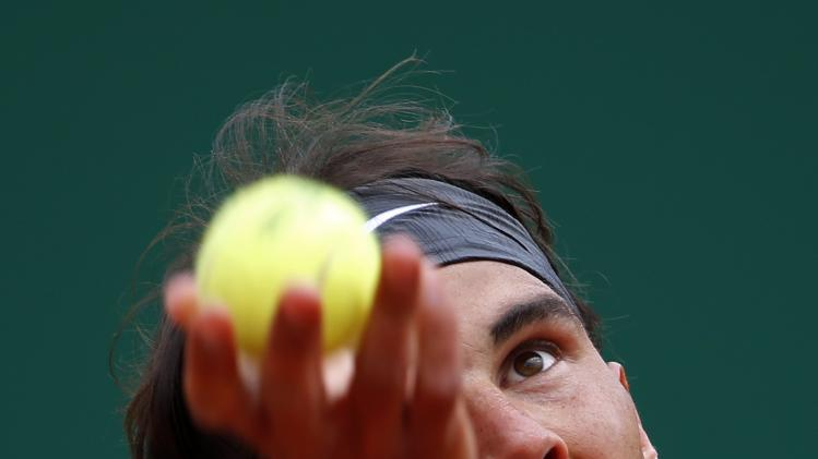Rafael Nadal of Spain serves to Teymuraz Gabashvili of Russia during the Monte Carlo Masters in Monaco