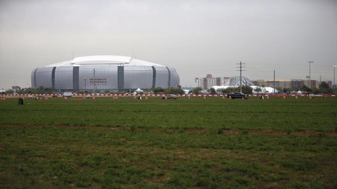 The University of Phoenix Stadium, where the Super Bowl XLIX will be held on Sunday, and the Westgate shopping mall are seen next to farm fields in Glendale