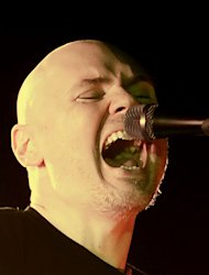 Billy Corgan vows to return to Philippines after rained out show