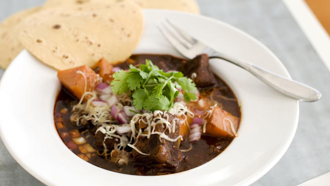 In this image taken on January 7, 2013, Mexican beef brisket and winter squash chili is shown served in a bowl in Concord, N.H. (AP Photo/Matthew Mead)