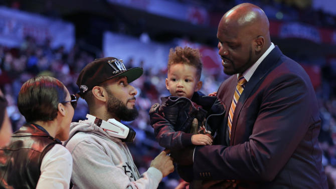 Singer Alicia Keys, left, and her husband, Swizz Beatz, second from left, take back their son, Egypt, after a picture with Shaquille O'Neal, right, during NBA basketball All-Star Saturday Night, Feb. 16, 2013, in Houston. (AP Photo/Eric Gay)