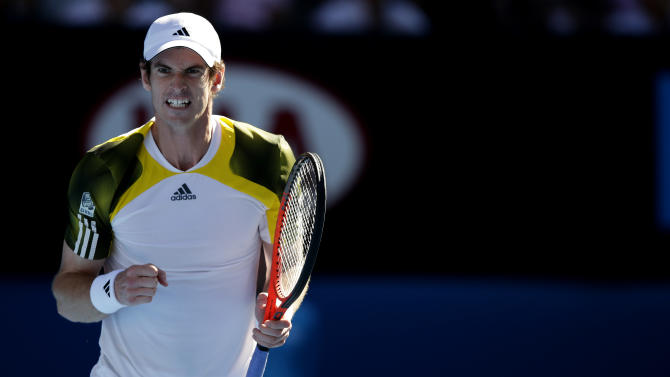 Britain's Andy Murray celebrates during his third round match against Lithuania's Ricardas Berankis at the Australian Open tennis championship in Melbourne, Australia, Saturday, Jan. 19, 2013. (AP Photo/Andy Wong)