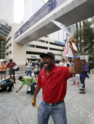 Franz Nertte, of Miami, shouts during a protest march in Tampa, Fla., Sunday, Aug. 26, 2012. Hundreds of protestors gathered in Gas Light Park in downtown Tampa to march in demonstration against the Republican National Convention. (AP Photo/Dave Martin)