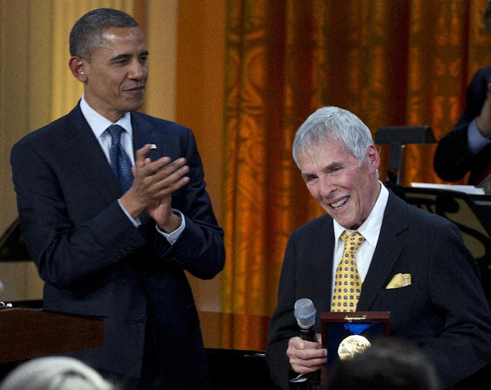 "President Barack Obama applauds after presenting songwriter Burt Bacharach with a 2012 Library of Congress Gershwin Prize for Popular Song during the ""In Performance at the White House"" in the East Room of the White House Wednesday, May 9, 2012, in Washington. (AP Photo/Carolyn Kaster)"