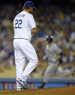 Clayton Kershaw (left) looks on as Chase Headley rounds third after his home run. (AP)