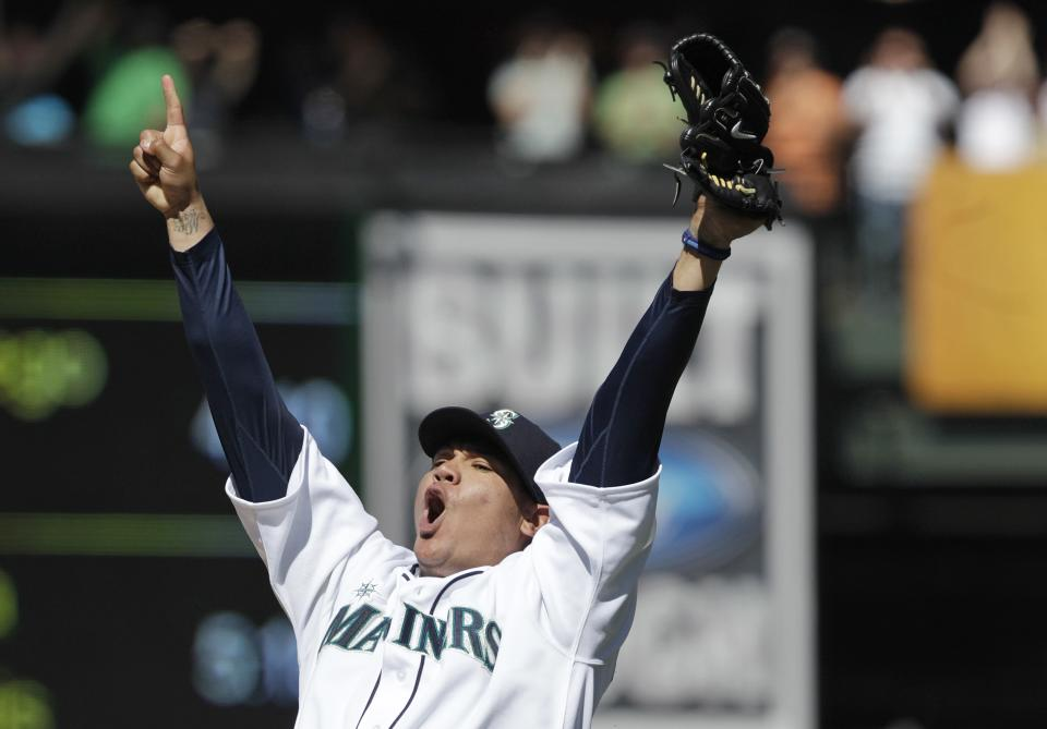 Seattle Mariners pitcher Felix Hernandez celebrates after throwing a perfect game against the Tampa Bay Rays, in a baseball game Wednesday, Aug. 15, 2012, in Seattle. (AP Photo/Ted S. Warren)