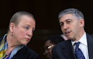 HSBC Chief Legal Officer Stuart Levey (R) speaks with President and CEO of HSBC Bank USA Irene Dorner during a hearing on Capitol Hill in Washington, DC, July 17. Shares in global banking giant HSBC fell more than two percent in Hong Kong on Wednesday after a top executive resigned over the lender's failure to control money laundering and terrorist financing