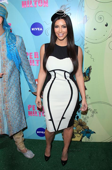 Celebrity fashion: Kim Kardashian has some gorgeous curves which are only complimented by this white dress with black detailing.