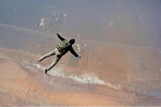 An Iranian skydiver jumps from a helicopter outside Tehran, Iran, Friday, March 7, 2014
