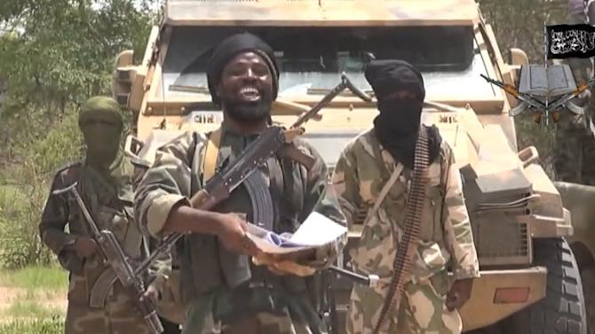 A screengrab taken on July 13, 2014 from a video released by the Nigerian Islamist extremist group Boko Haram and obtained by AFP shows the leader of the Nigerian Islamist extremist group Boko Haram, Abubakar Shekau (centre)