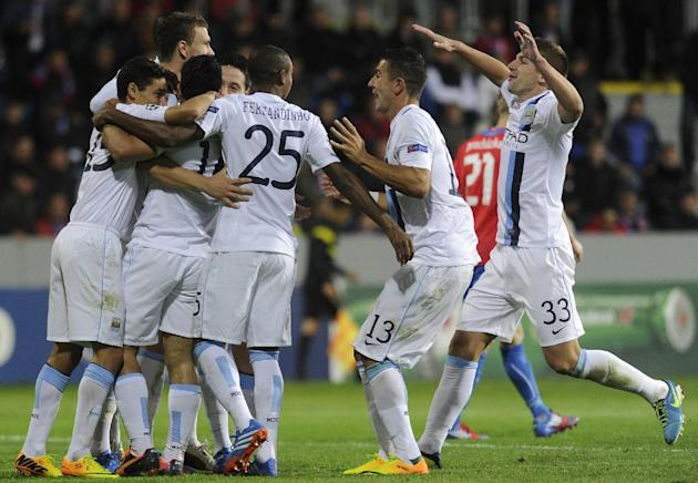 Manchester City's players celebrate their first goal during the Champion's League Group D soccer match against Viktoria Plzen in Plzen, Czech Republic, Tuesday, Sept. 17, 2013. (AP Photo, CTK/Michal K