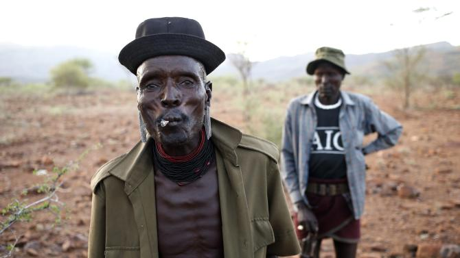 Turkana man smokes in a village inside the Turkana region of the Ilemi Triangle